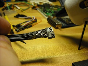 Wires hotglued together and header is wrapped in hotglue.