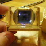 Through-lens optical sensor
